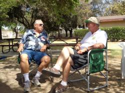 Roger Heath & Craig Bumgarner enjoy catching up under the shade of the old oak tree.