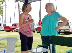 Michele (Givens) Holliday & Susie (Johnson) Olivo discuss where to set up the lunch table and display all the food.