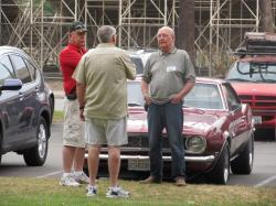 Wayne Giroux shows off his classic Camero to Craig Bumgarner and Cliff (spouse)